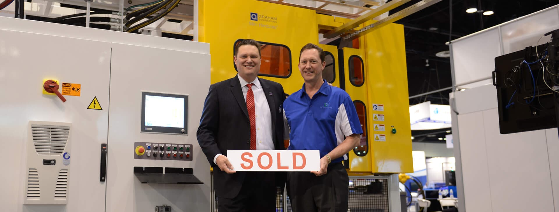 COO Patrick Lindsey with Graham CEO Dave Schroeder in front of a new mini Hercules