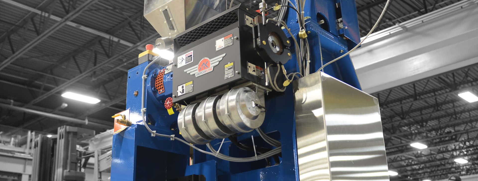 AKcent extruder in royal blue in a factory setting