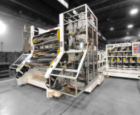 Graham sheet extrusion machine pictured in white in a factory setting welex
