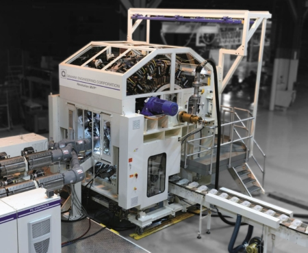 revolution MVP, a white rotary blow molding machine on a dark background