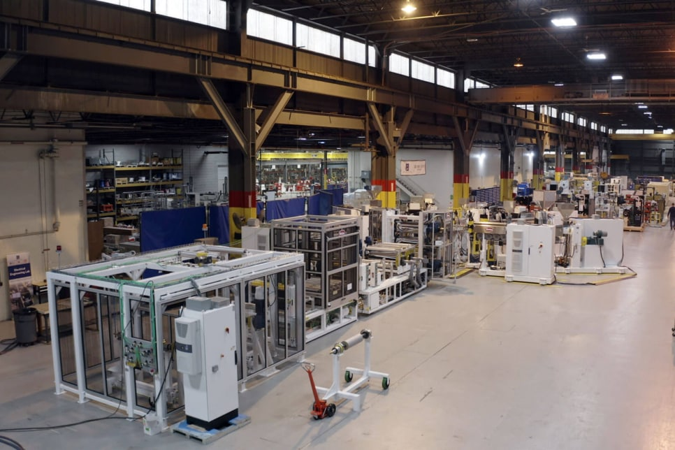 Extruder equipment pictured in a factory setting