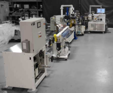 American Kuhne brand extrusion system shown in a factory setting.