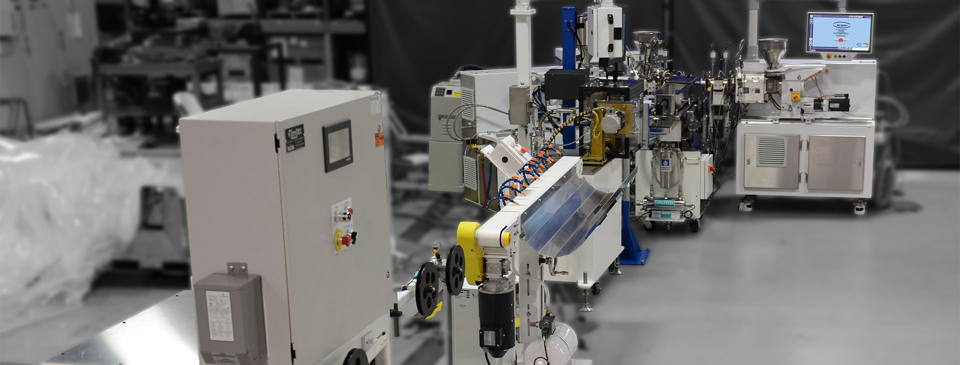 extrusion system shown with multiple modules in a factory setting