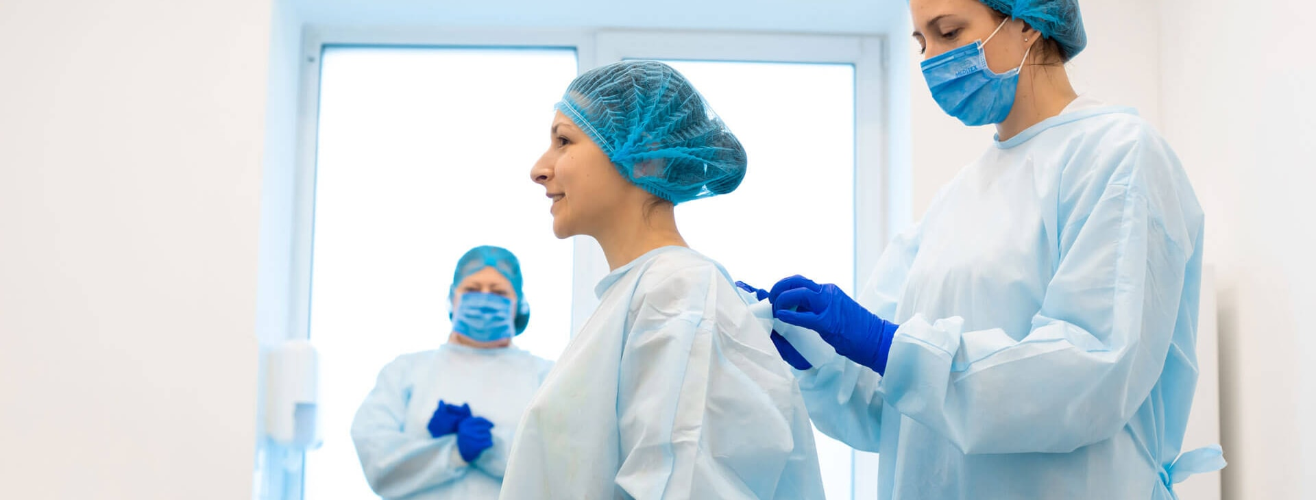 Medical industry shown with personnel in scrubs, gloves