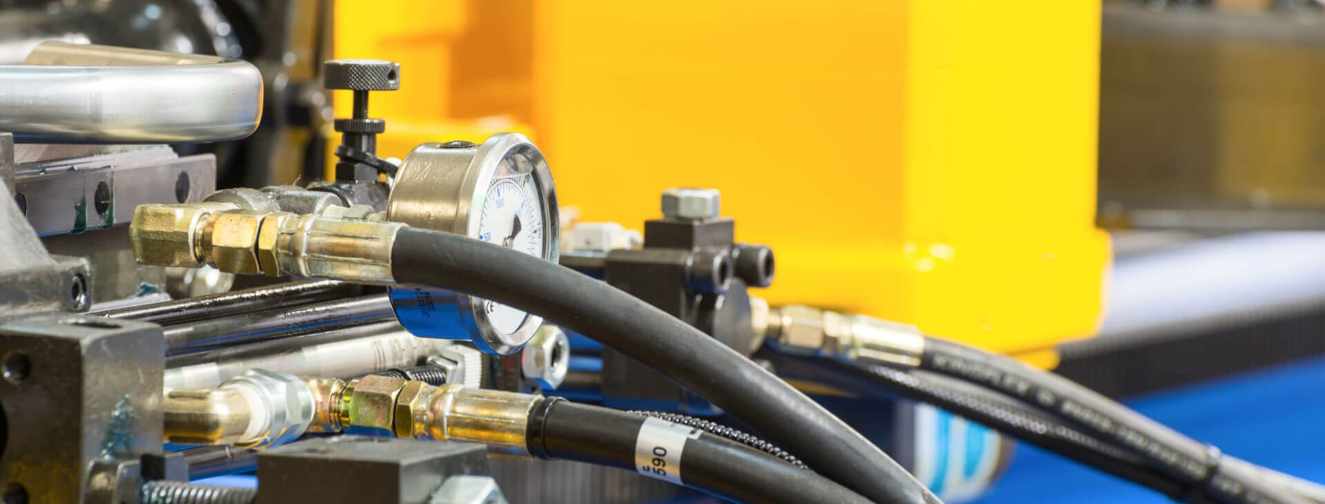industrial tubing shown attached to a yellow and blue machine
